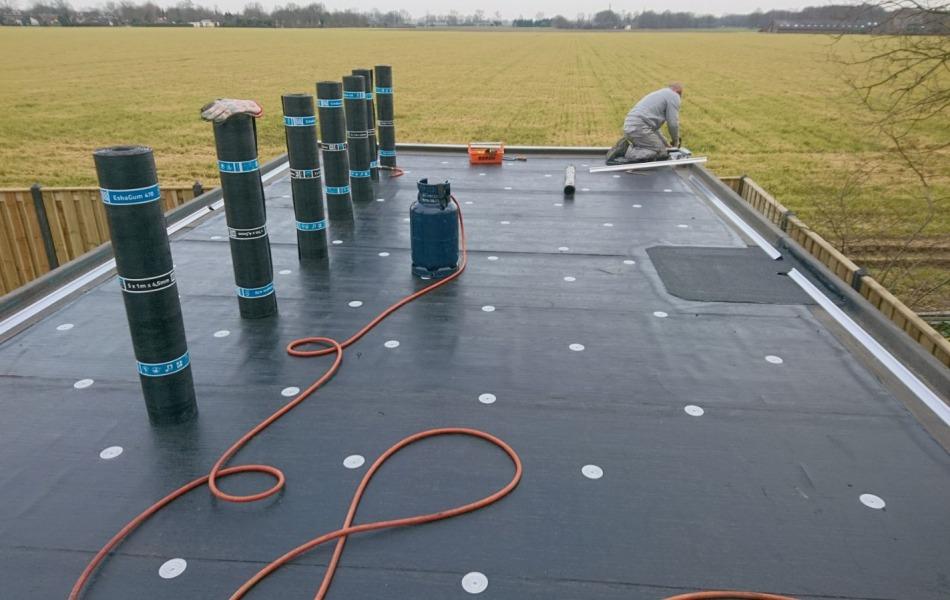 Dakdekker voor platte dak in Tiel