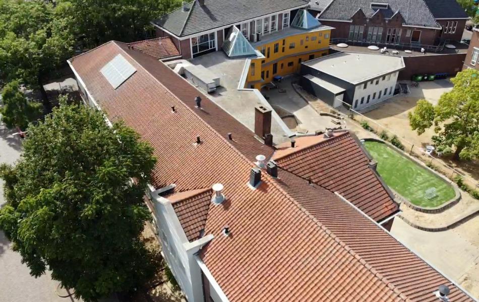 Dakrenovatie monumentaal schoolgebouw karel de grote nijmegen door ervaren dakdekker groot