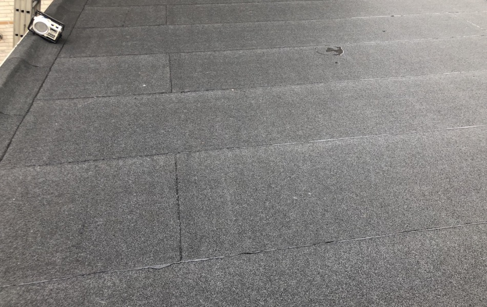 Renovatie van plat dak woonhuis malden